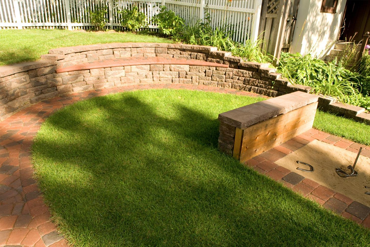 Modular block retaining wall with built-in seat bench.