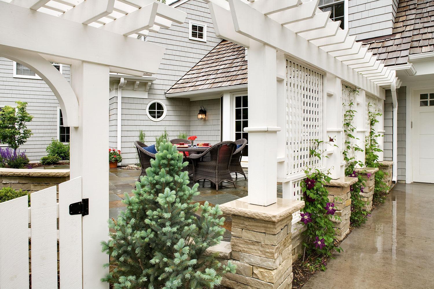 Custom-designed white trellis separated the driveway from the dining patio