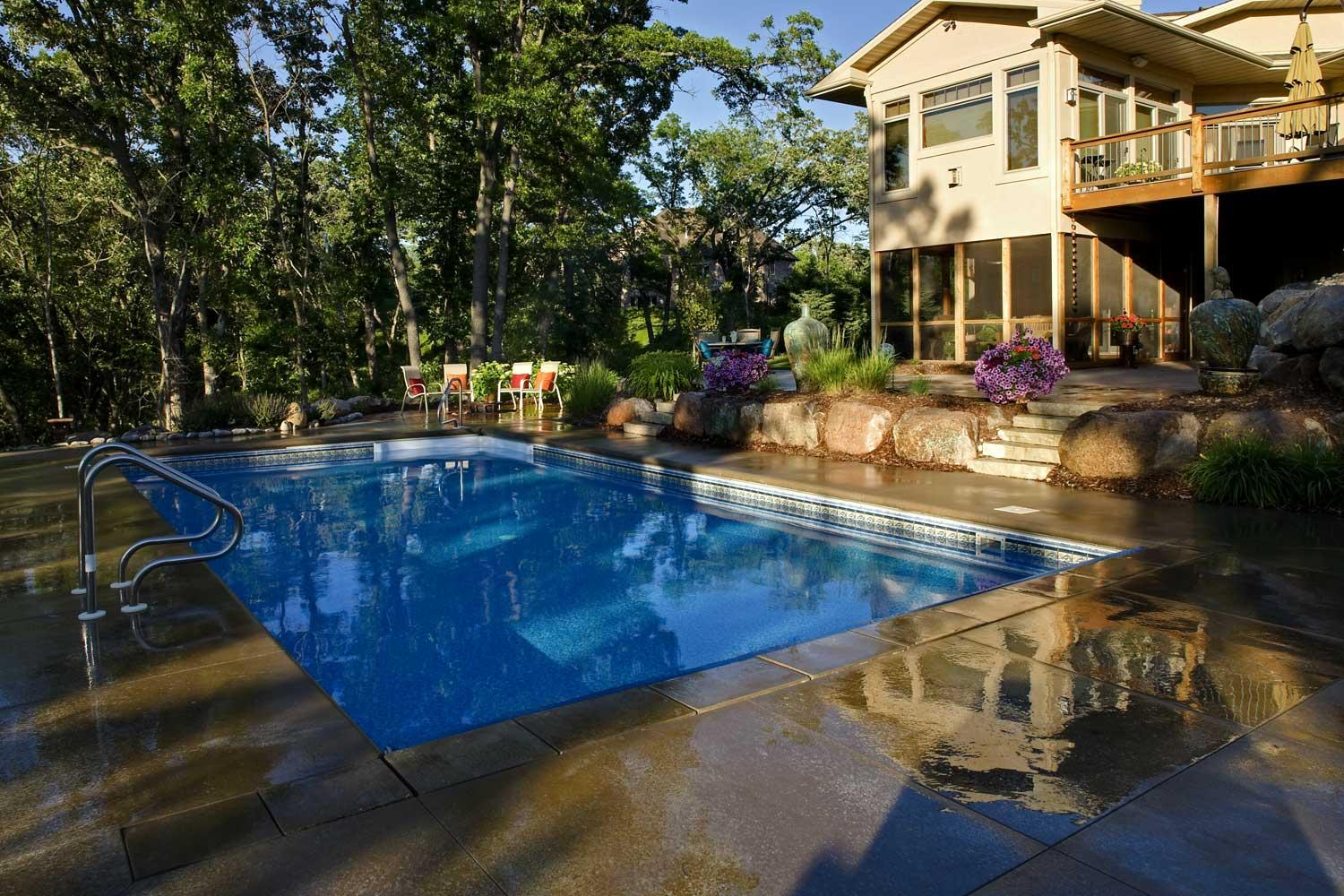 Shady backyard swimming pool in inver grove heights