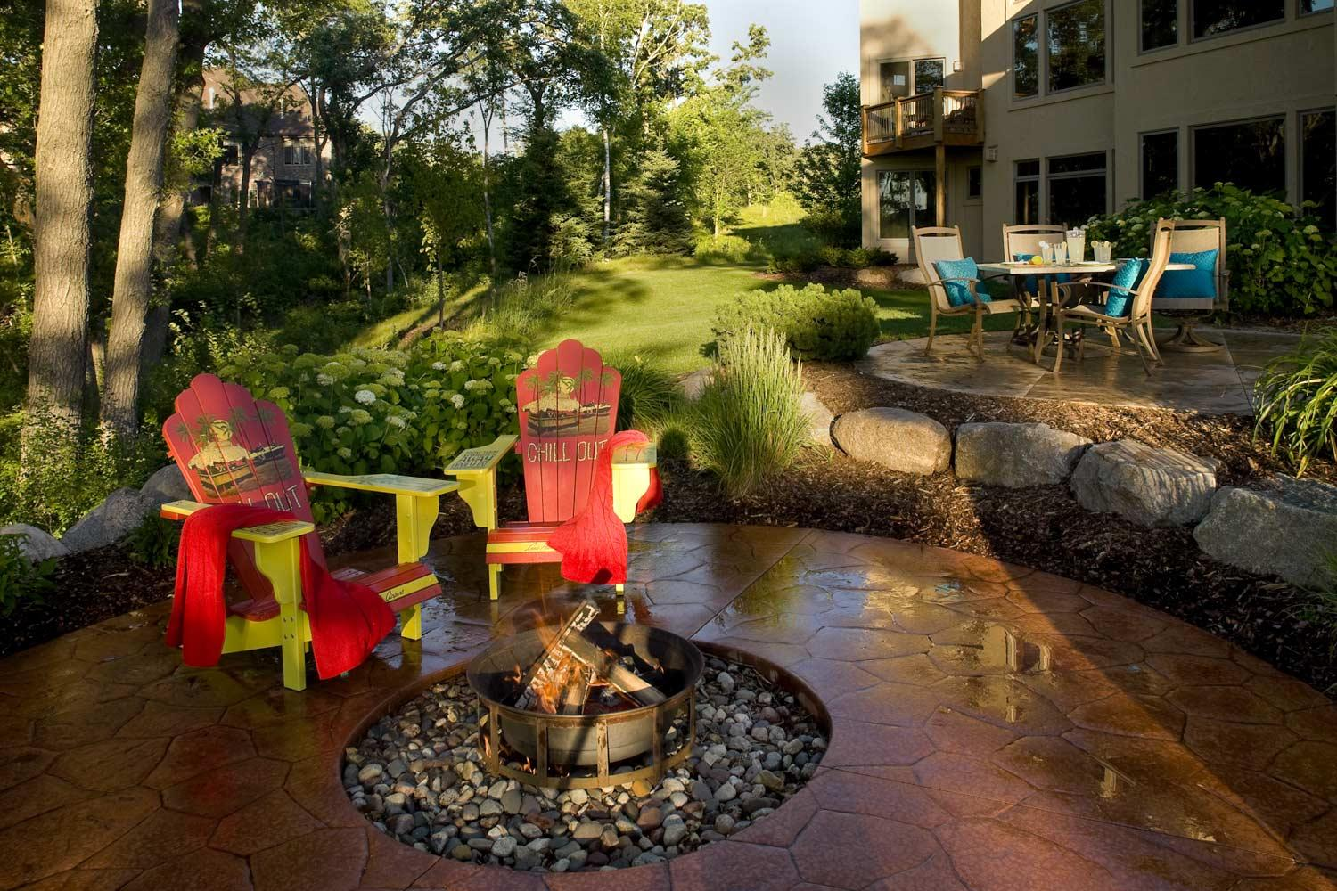 Stamped concrete fire circle firepit patio design