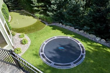 Backyard in-ground trampoline and putting green