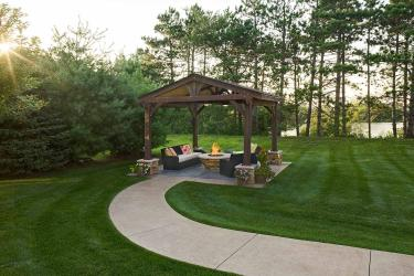 ADA wheelchair accessible path leads to a cover outdoor living room