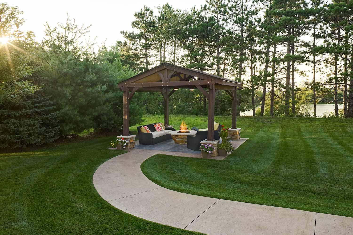 Lakeside outdoor living room with custom fire table