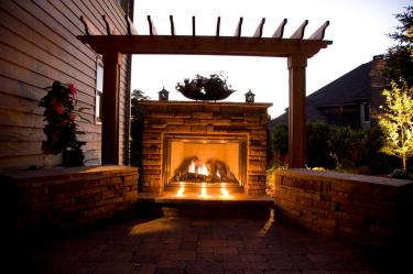 Pergola with stone fire place, patio, and retaining walls