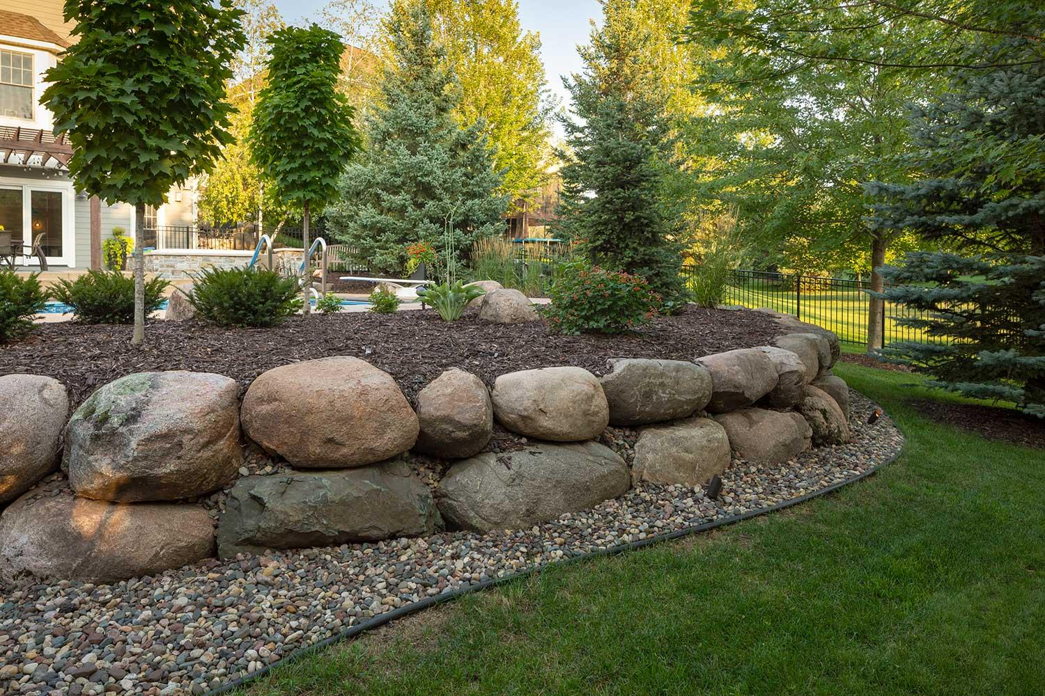 boulder retaining wall and garden