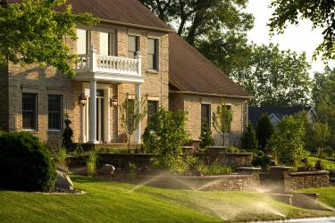 Traditional Brick Home with Retaining Walls and Irrigation System