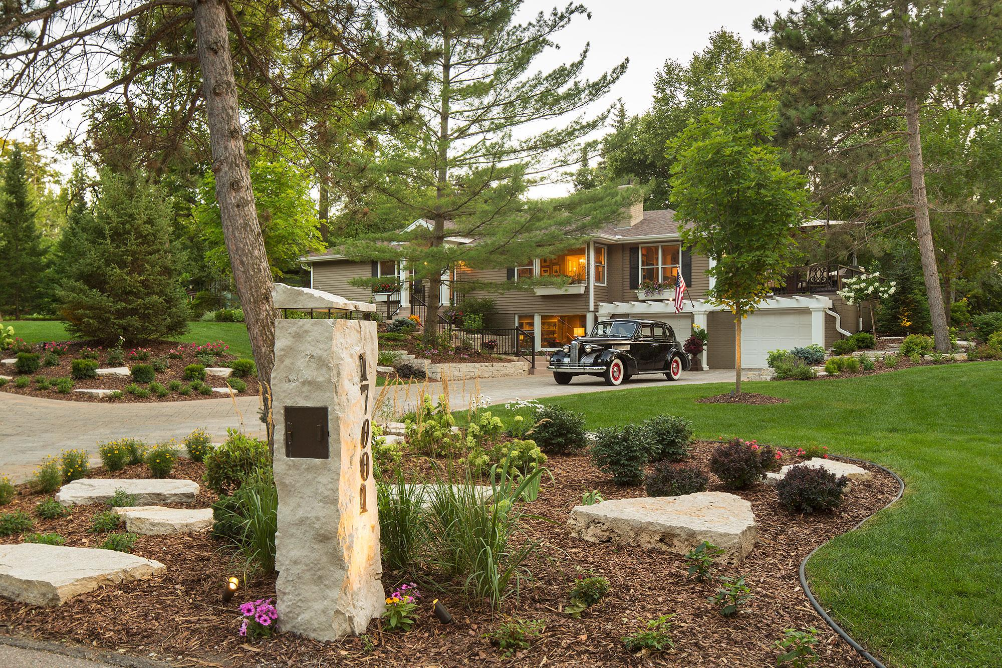 Stone Mailbox with LED lighting Surrounded by Shrubs and Perennials