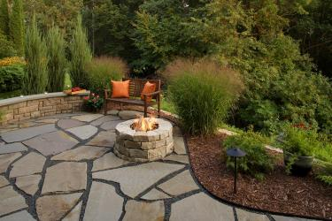 Natural stone fire pit and patio on the edge of a gorge.