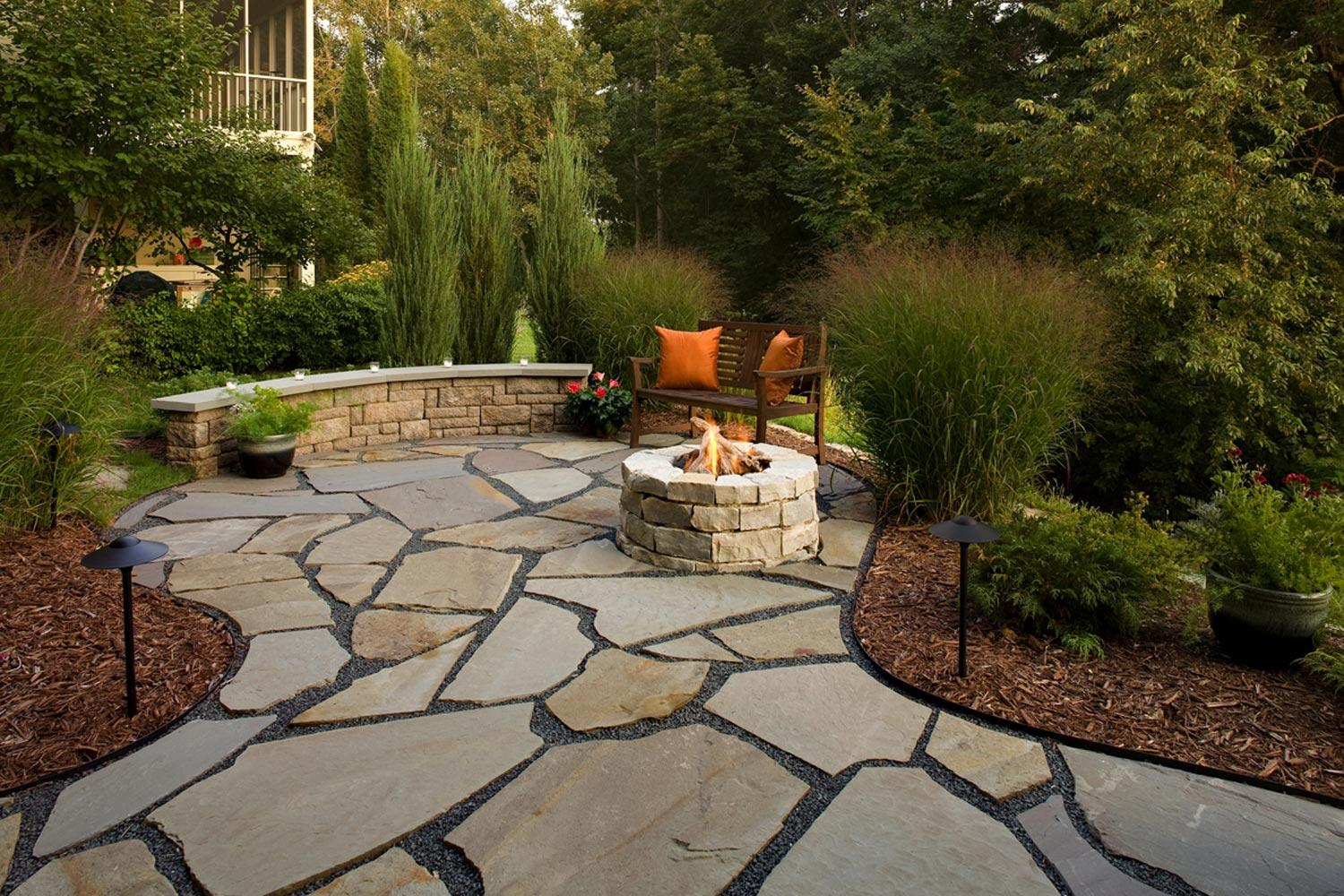 Stone patio and fireplace in Golden Valley, MN backyard landscape