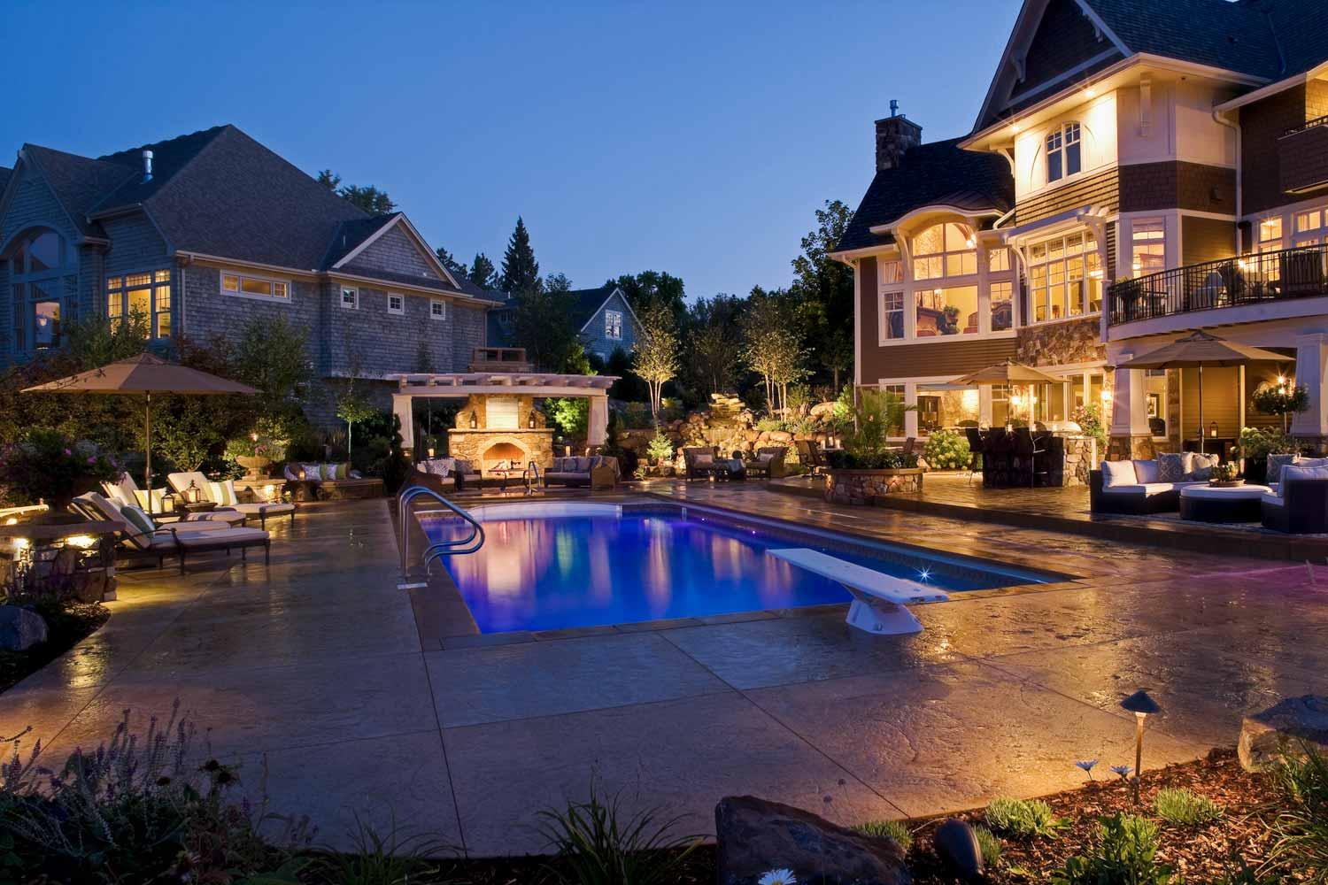 Luxury backyard lit up at night
