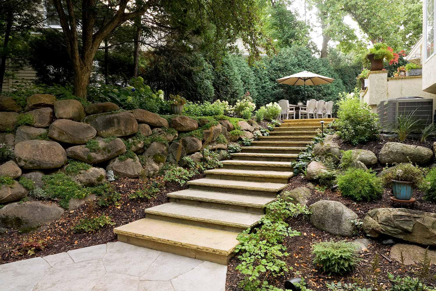 backyard staircase design with limestone treads