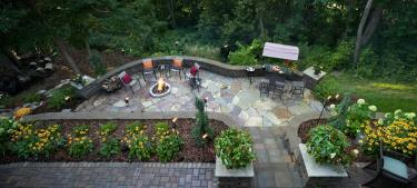 Northwoods style multi-level natural stone and paver patios. Minneapolis Metro Area