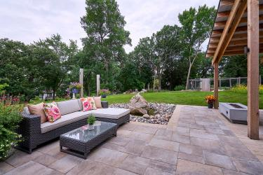 Sitting patio with large format pavers and a brick paver border.