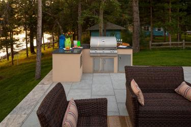 Basic outdoor cooking station with built-in natural gas grill, storage, and a solid countertop.