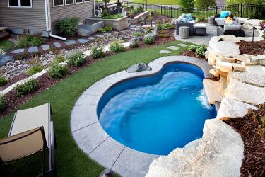 Small plunge pool surrounded by artificial turf.