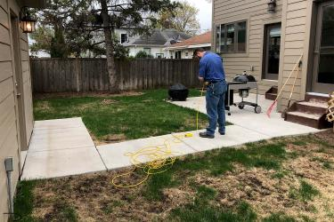 Small minneapolis backyard with brown spots torn up and destroyed by dog paws and urine.