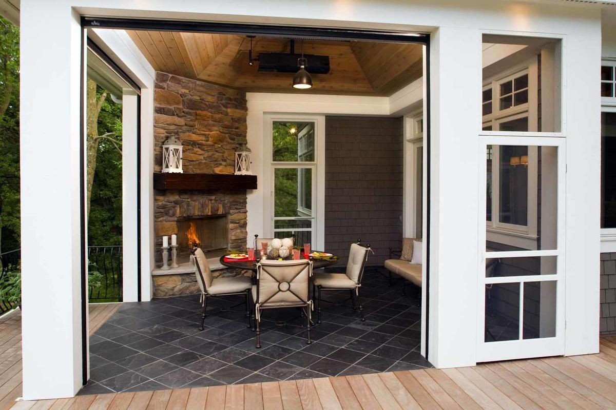 Three-season dining patio with tile floors, fireplace, and retractable screens