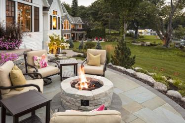 Natural stone fire pit patio on a boulder terrace