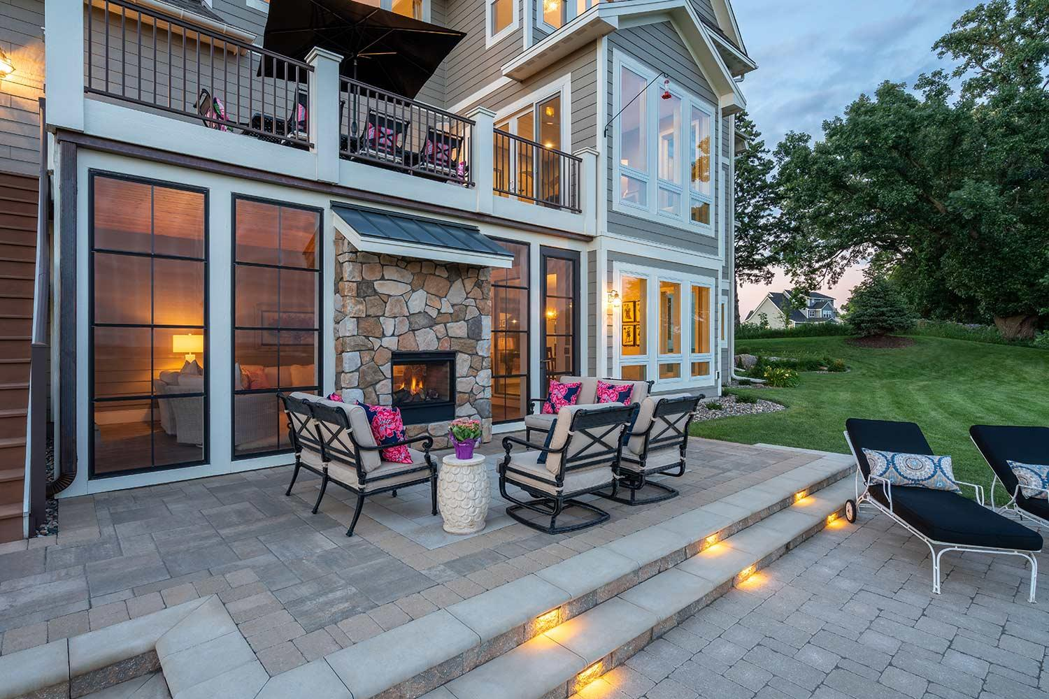 unique fire place and outdoor living room in eden prairie landscape design