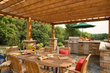Outdoor kitchen and dining room under the pergola