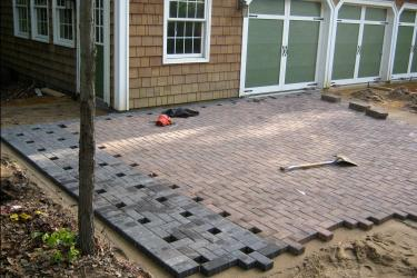 In progress custom basketball court paver driveway installation Minneapolis, mn