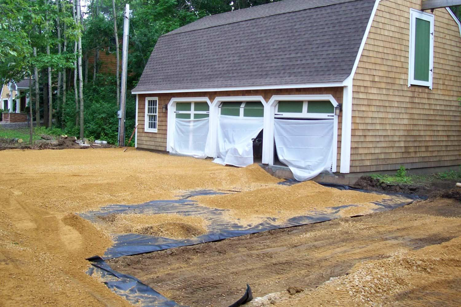 Excavated driveway creating a level base