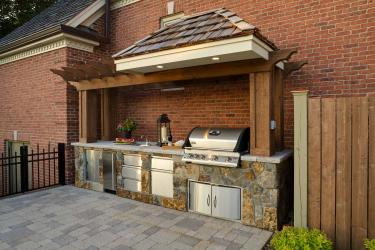 Backyard kitchen designed to match the house