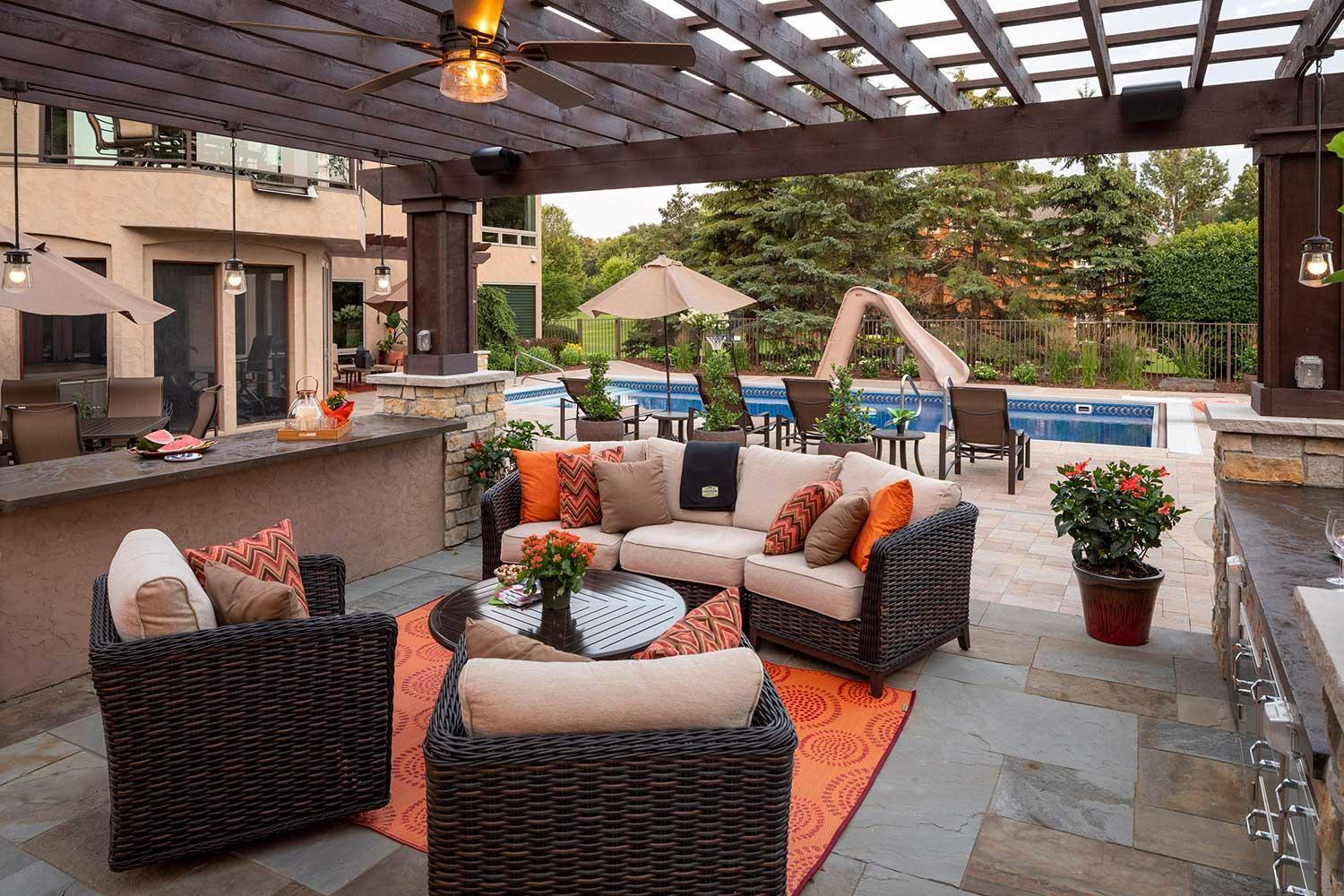 luxury outdoor living room with bluestone patio and ceiling fan