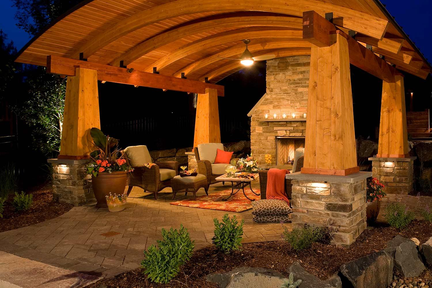 outdoor room with fireplace and aching ceiling