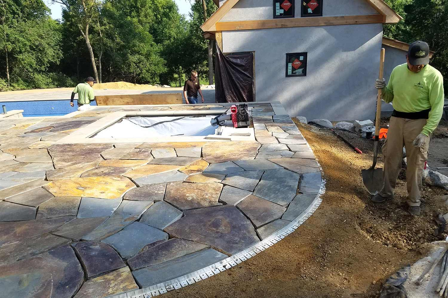 Southview Design's construction crew installing the natural stone patio.