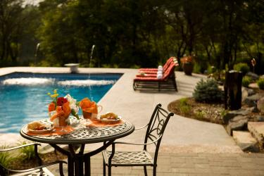 Poolside cafe table and lounge chairs