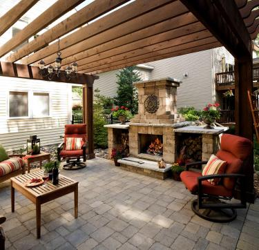 Pergola covers the entire patio in this outdoor living room backyard landscape in savage