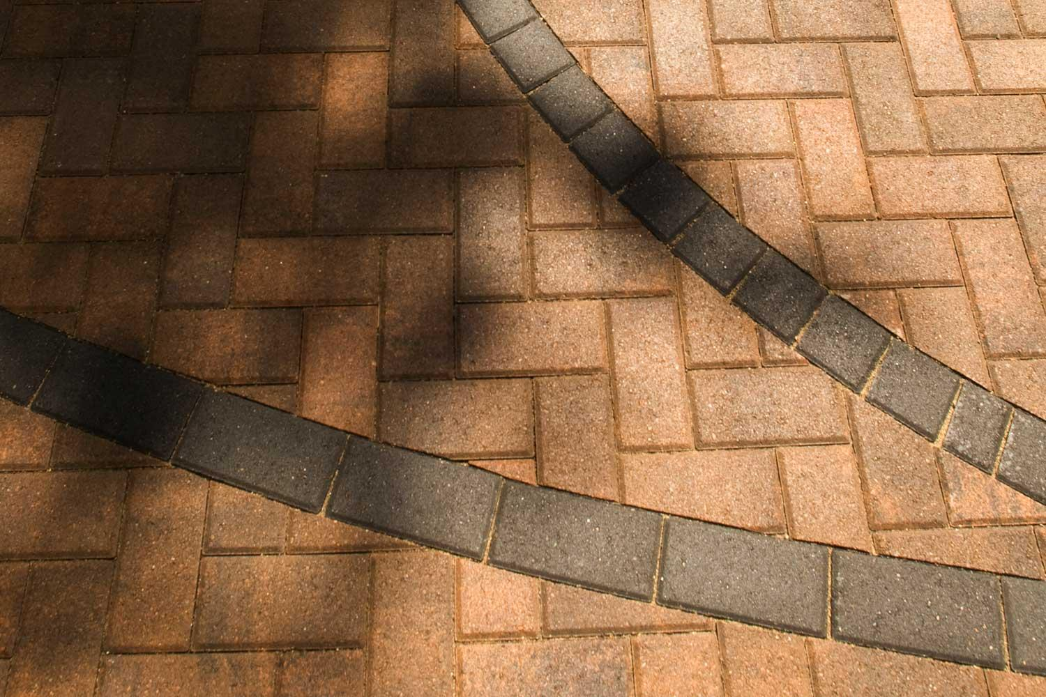 Beautifully inset basketball court lines in the brick driveway
