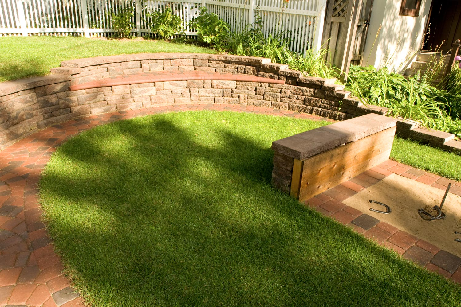 Concrete Block Seat Wall and Horseshoe Pitch in Minneapolis Mn Side Yard