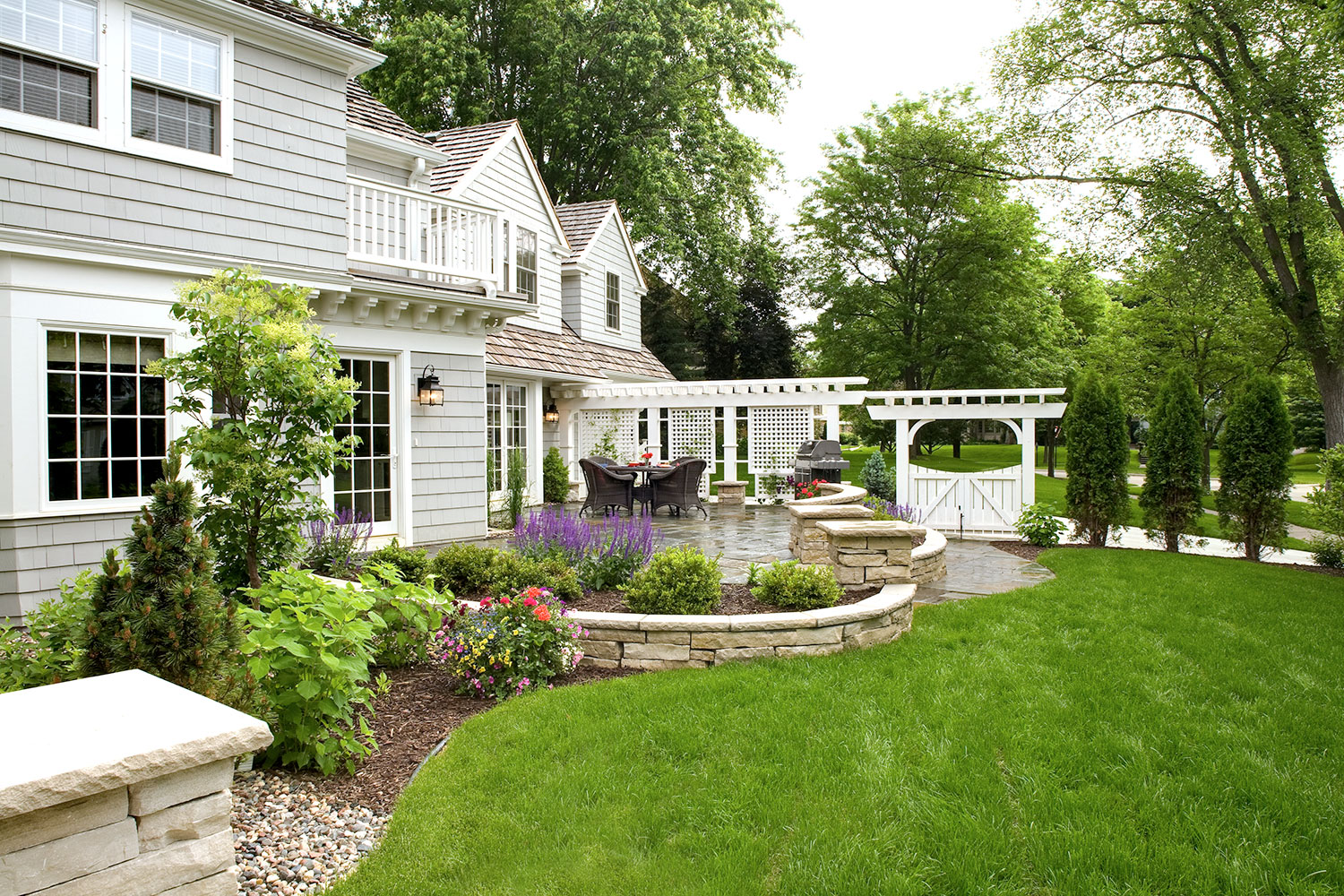 Edina MN Sideyard Landscaping with Patio, Chilton Wall, White Arbor and Gate