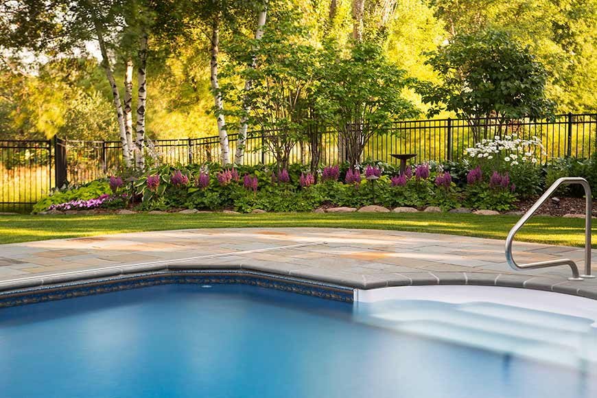 Swimming Pool Landscaping with Aluminum Fencing