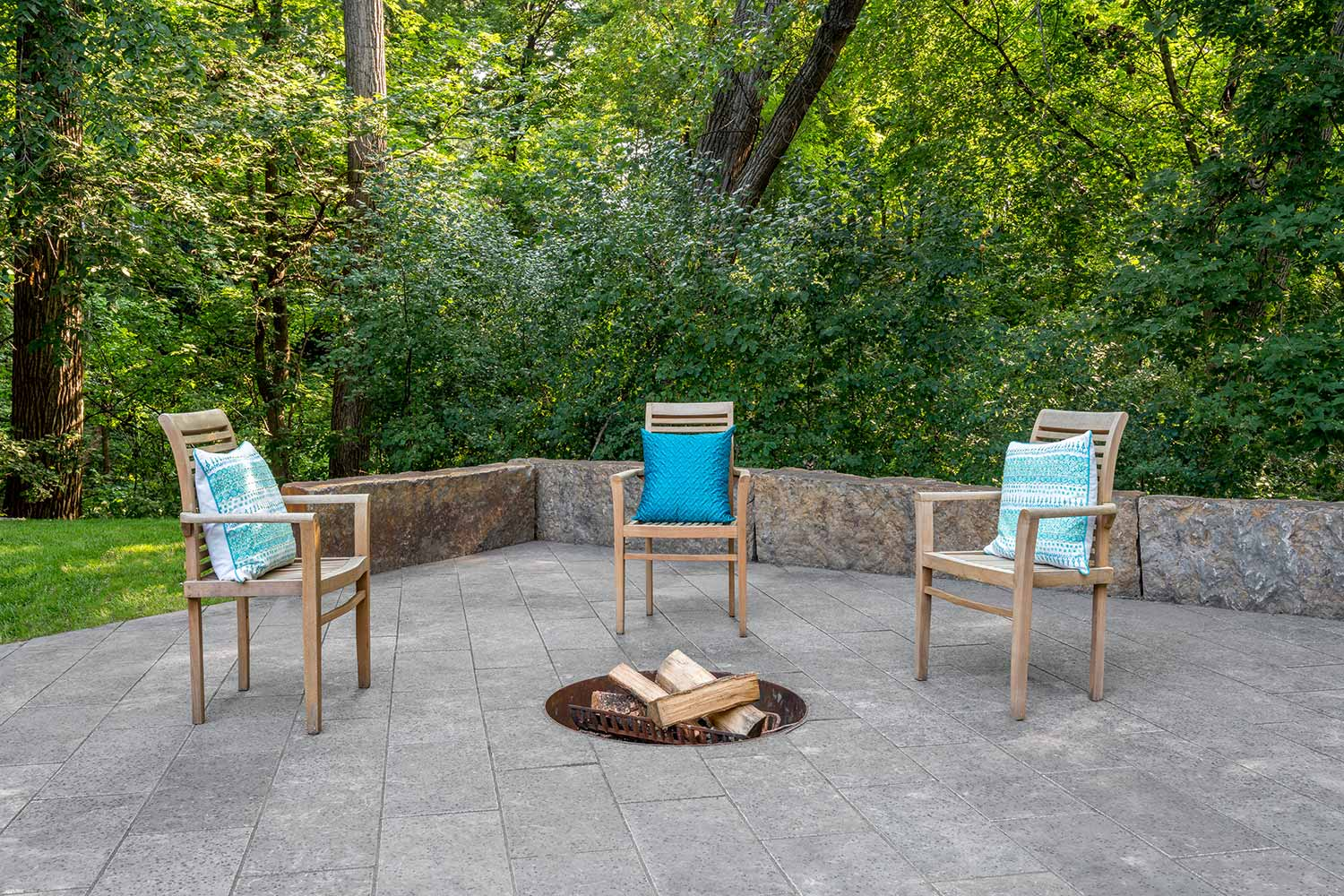 in ground wood-burning fire pit with 45 degree diagonal pavers and missouri ledgestone seat wall