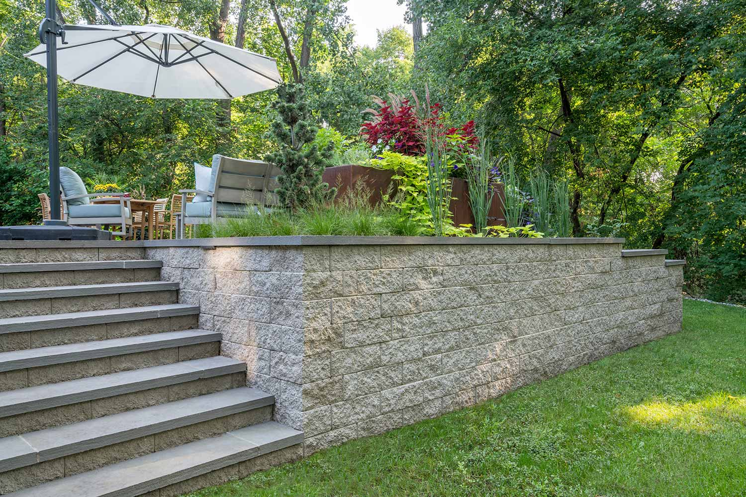 modular brick retaining wall patio with built in planters