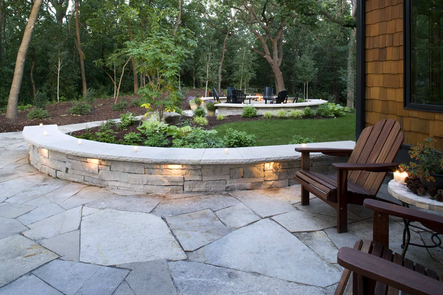 Natural stone path and stacked stone retaining wall