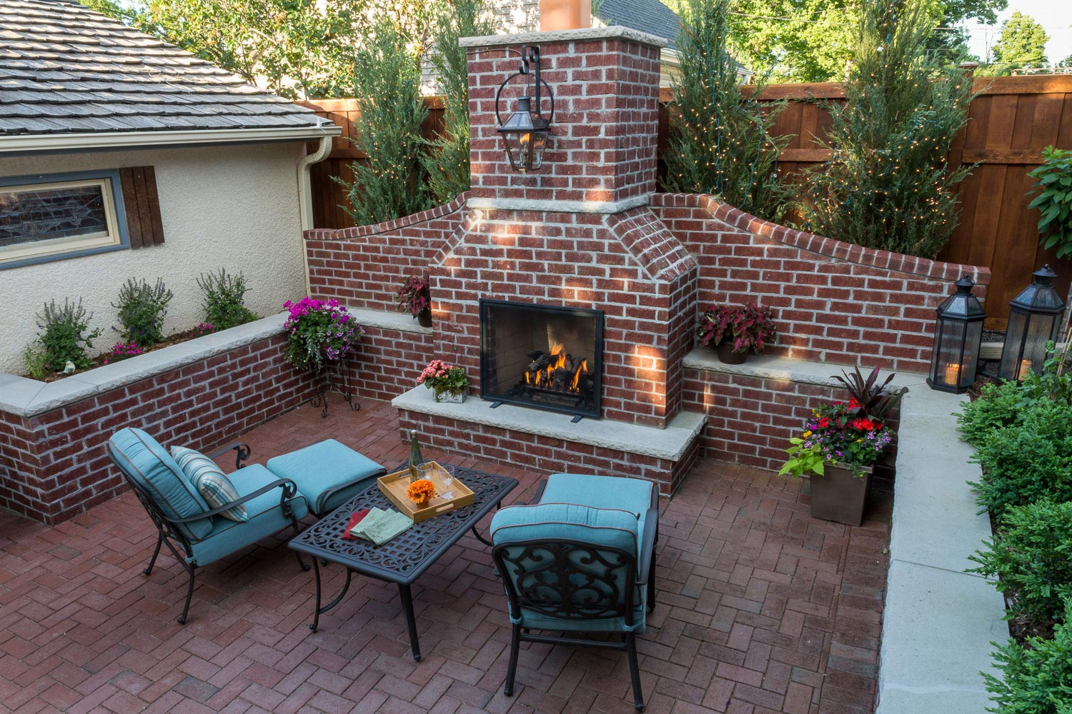 Red brick backyard fireplace and patio in St. Paul MN