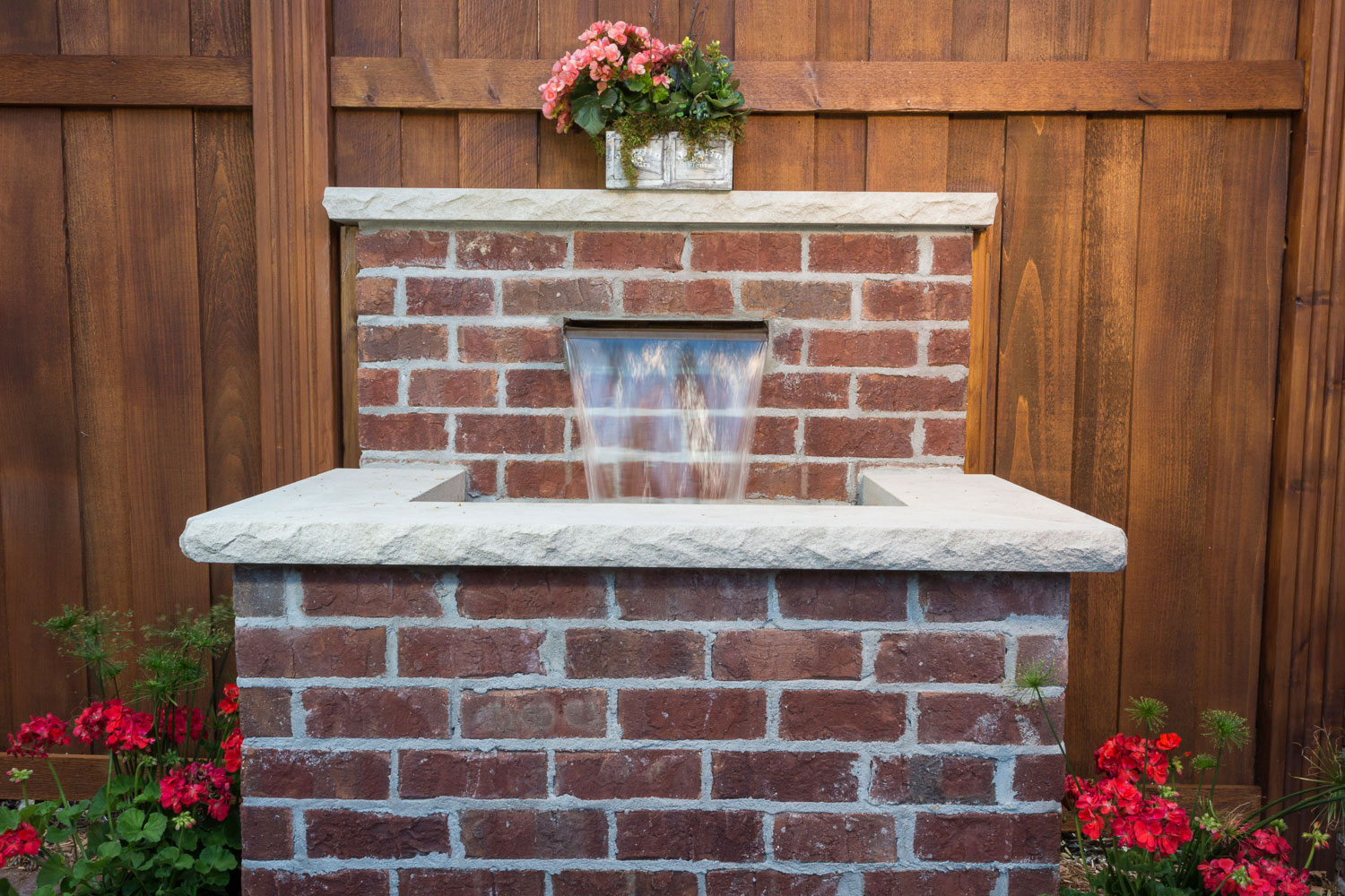 French Quarter-inspired backyard water fall feature design