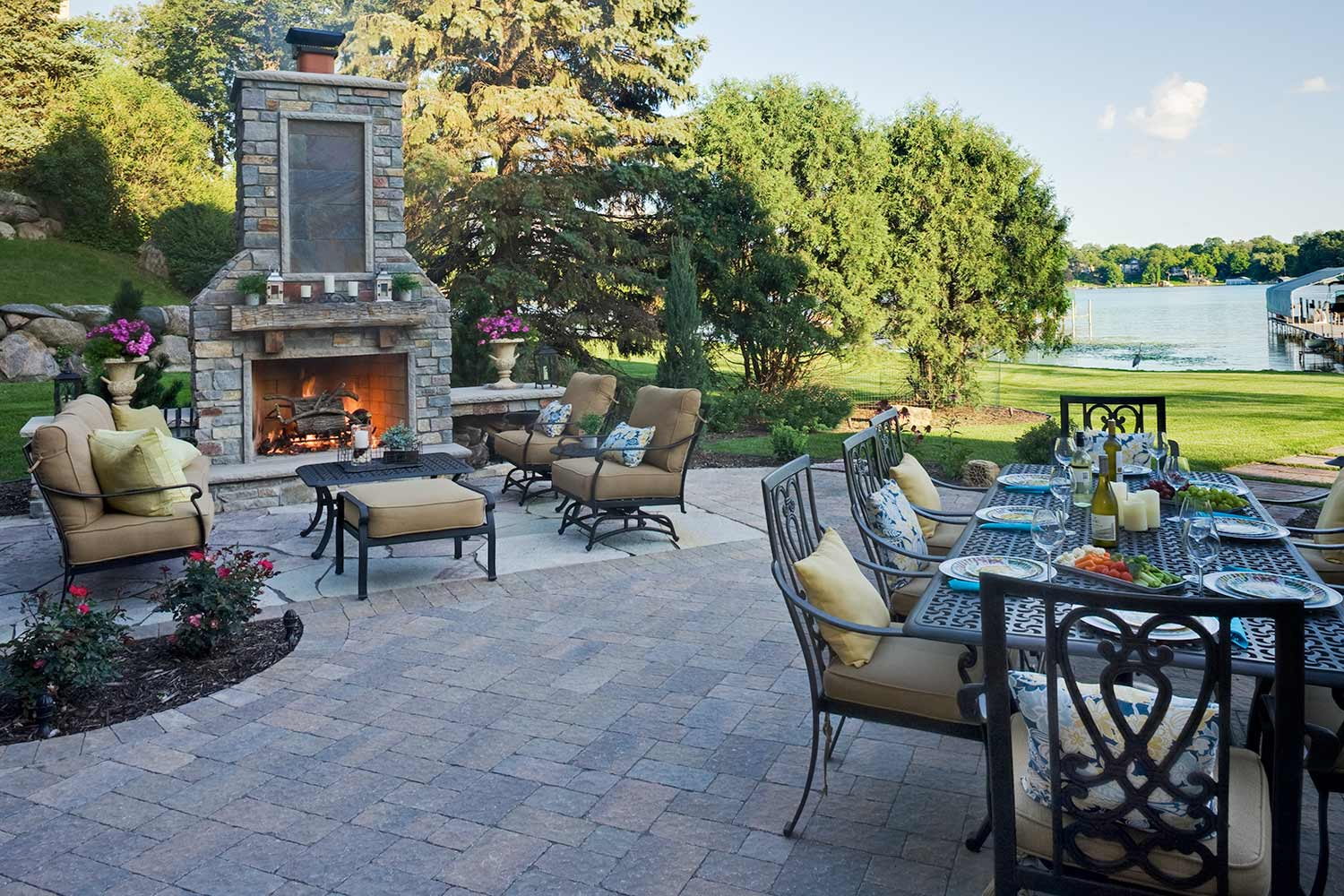 Multipurpose fireplace and dining room backyard paver patio design and installation