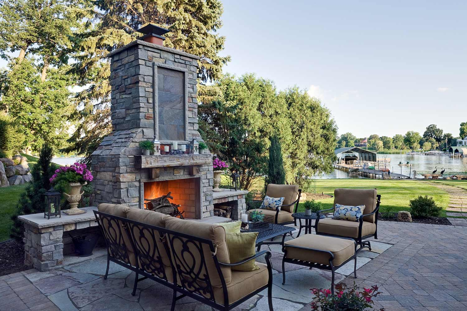 cottage stone backyard fireplace and custom paver patio design