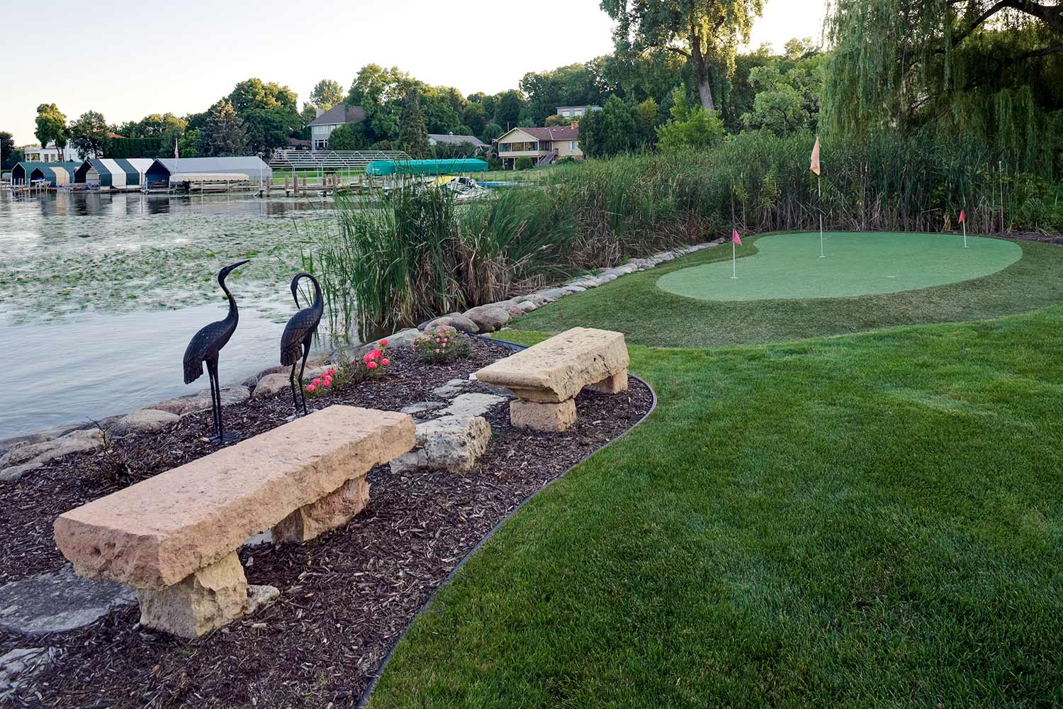 stone benches and putting green overlooking lake minnetonka