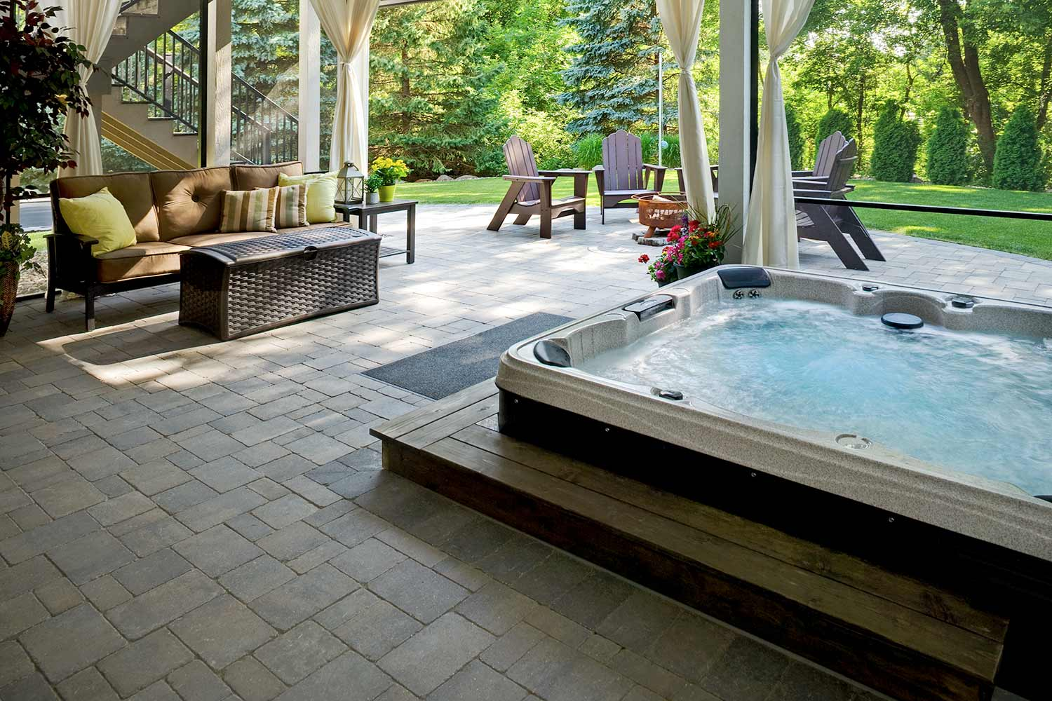 sunked hot tub and outdoor living room with bug screens and curtains