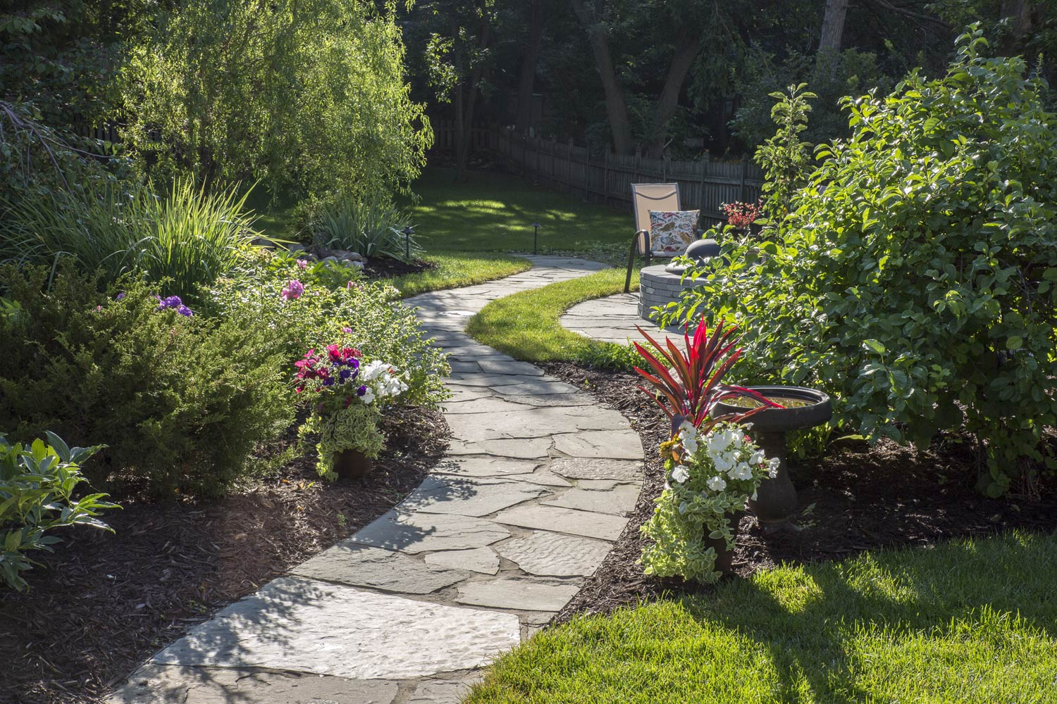 Winding garden path in Edina MN back yard landscape design