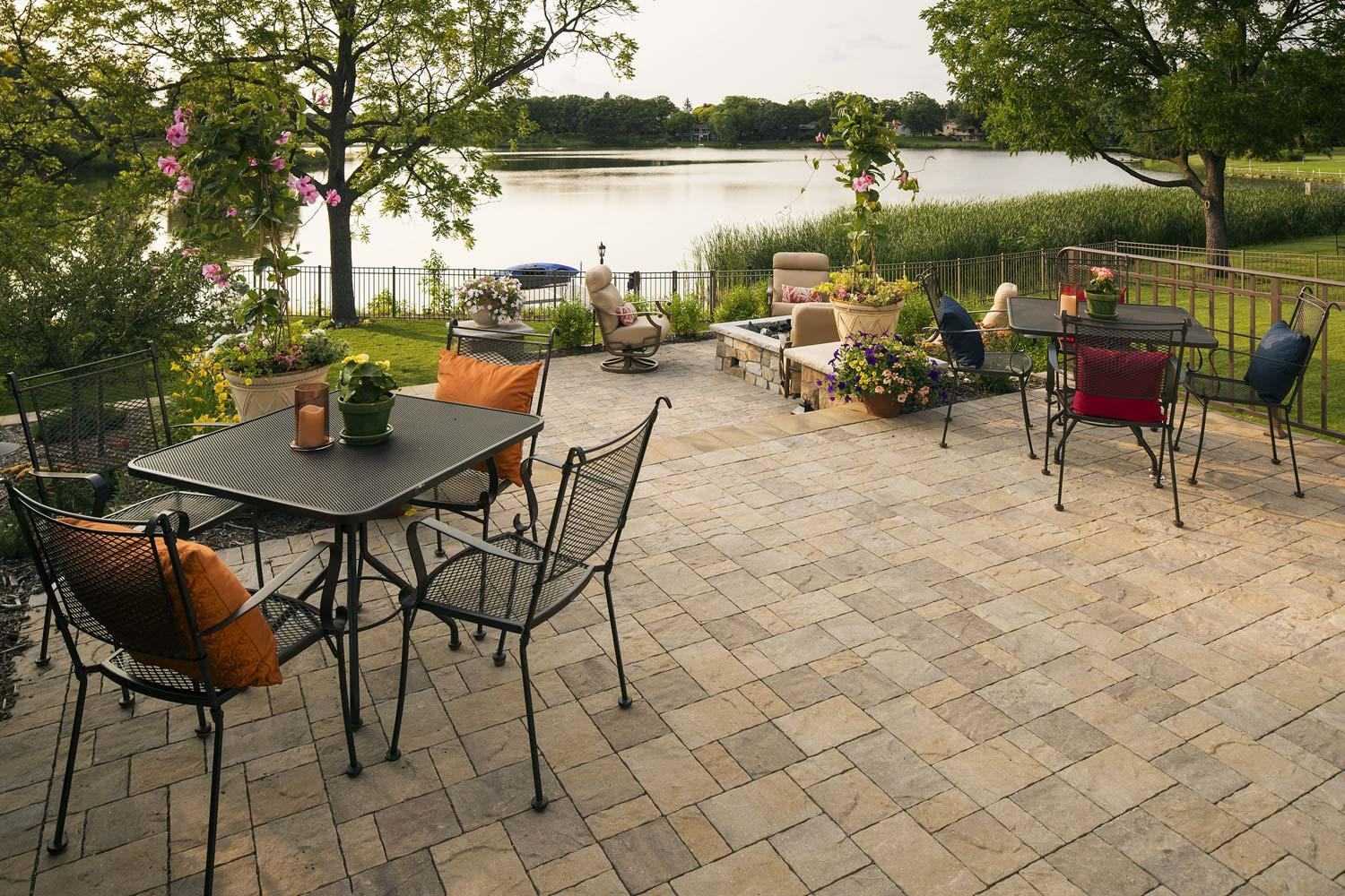 multi-level backyard patio with room for furniture and a fire table by the lake in edina, MN