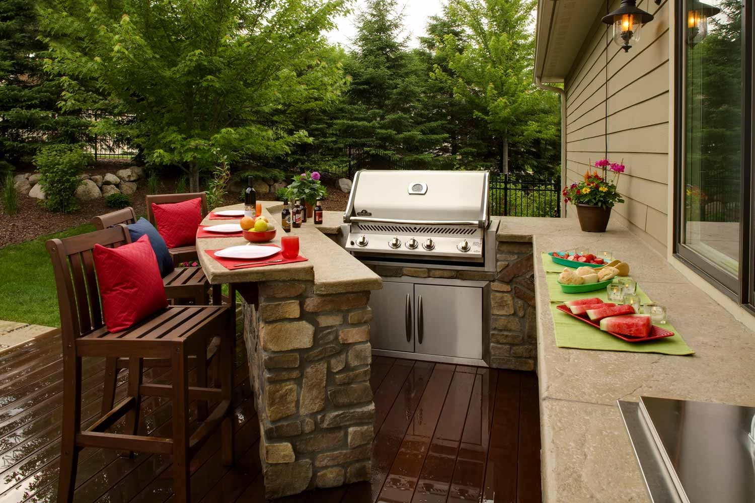 Outdoor kitchen with build in grill and two level bar counter