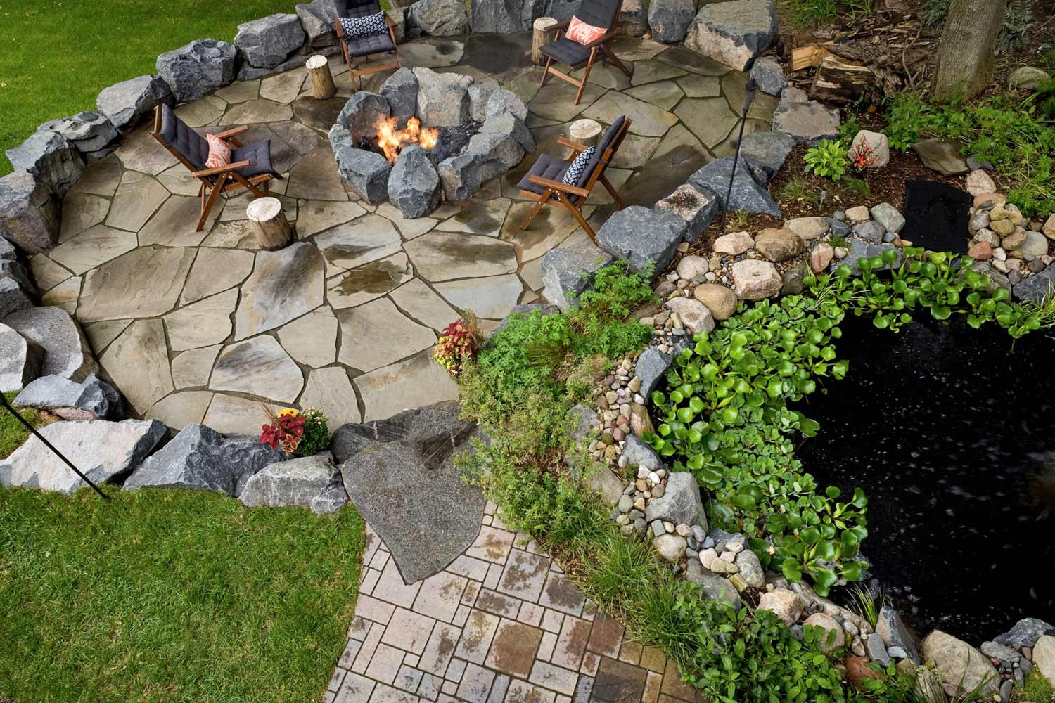 aerial view of the fish pond, natural stone patio, and paver walkway