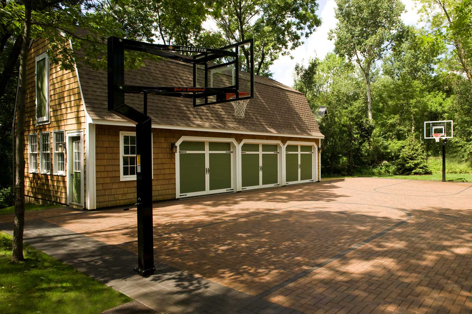 Inlaid paver sport court driveway